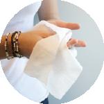 hands using sanitising wipe